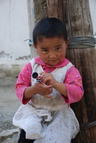 """Finger puppets seem silly until you see sweetness like this. This little girl got """"snowman."""" I managed to unload two dozen during the trip."""