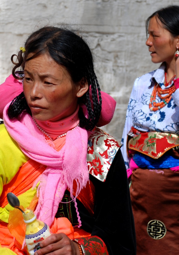 I  love how colorful their outfits are. Notice the plastics water bottle, it is filled with yak butter used in the monastery lamps.
